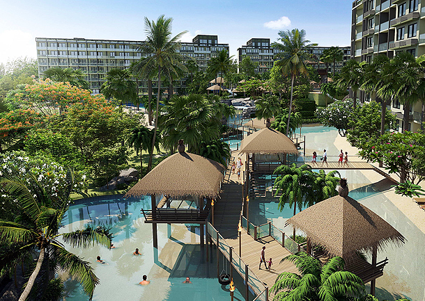 Pfahlhäuser im und neben dem Schwimmbad The Maldives Pattaya Jomtien